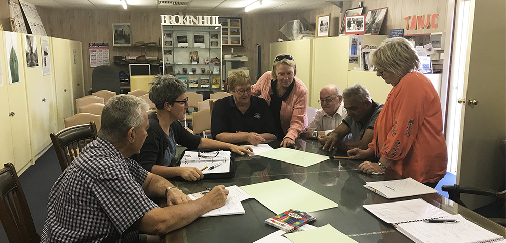 Broken Hill museum volunteers meet in the research room at the rear of the Synagogue of the Outback with Museum Advisor, Kate Gahan.