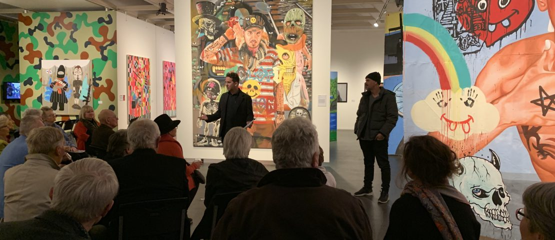 Gallery Director Bradly Hammond and David Griggs (right) discussing the exhibition, Orange Regional Gallery, 2019