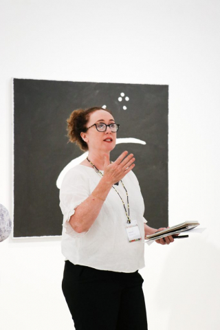 BRAG Director Sarah Gurich speaks to Education Symposium attendees