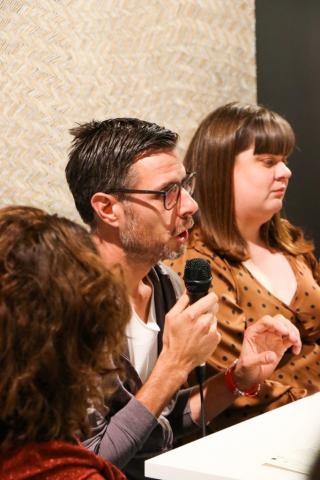 Jonathan Jones speaks on the panel talk